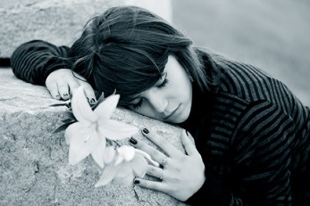 gravestone-lilies-grieving-girl